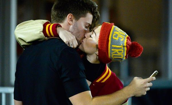 Miley Cyrus and Patrick Schwarzenegger Kiss at USC Football Game